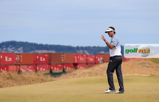 Bubba Watson (USA) sinks his putt on the 17th green as a freight train passes by during Thursday's Round 1 of the 2015 U.S. Open 115th National Championship held at Chambers Bay, Seattle, Washington, USA. 6/18/2015.<br /> Picture: Golffile | Eoin Clarke<br /> <br /> <br /> <br /> <br /> All photo usage must carry mandatory copyright credit (&copy; Golffile | Eoin Clarke)