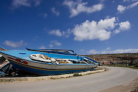 Cimitero delle barche...I barconi che trasportano i profughi vengono depositati in tre punti dell isola in attesa di essere smaltiti. ..Le barche depositate nella discarica dell isola...Lampedusa 05 Marzo 2011...Photo Serena Cremaschi Insidefoto..........