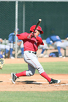 Alexi Amarista #2 of the Los Angeles Angels hits a homerun in a minor league spring training game against the Chicago Cubs at the Angels minor league complex on April 3, 2011  in Tempe, Arizona. .Photo by:  Bill Mitchell/Four Seam Images.