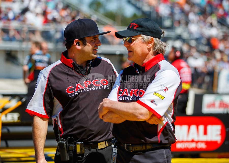 Mar 18, 2017; Gainesville , FL, USA; Richard Hogan (right), crew chief for NHRA top fuel driver Steve Torrence talks with Bobby Lagana during qualifying for the Gatornationals at Gainesville Raceway. Mandatory Credit: Mark J. Rebilas-USA TODAY Sports