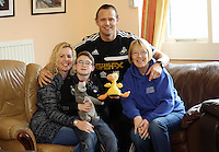Pictured L-R: Volunteer Allison Morgan with 10 year old James Morris, Swansea City FC ambassador Lee Trundle and Diane Morris who is James' mother and also a volunteer. Monday 17 March 2014<br />
