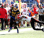 BROOKINGS, SD - OCTOBER 22:  Marquise Lewis #11 from South Dakota State University is knocked down by Nate Dortch #8 from Youngstown State in the first half of their game Saturday afternoon at Dana J. Dykhouse Stadium in Brookings. (Photo by Dave Eggen/Inertia)