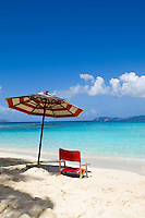 Hawksnest Beach with red striped umbrella.Virgin Islands National Park.St John, US Virgin Islands