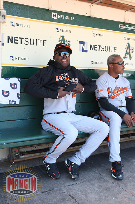 OAKLAND, CA - JUNE 7:  Felix Pie of the Baltimore Orioles gets ready in the dugout before the game against the Oakland Athletics at the Oakland Coliseum in Oakland, California on Sunday, June 7, 2009.  The Athletics defeated the Orioles 3-0.  Photo by Brad Mangin
