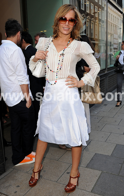 **ALL ROUND PICTURES FROM SOLARPIX.COM**.**WORLDWIDE SYNDICATION RIGHTS**.guests arrivals for the Chanel Boutique opening at Dover Street Market, London, UK. 10th June 2008..This pic: Tara Palmer Tomkinson..JOB REF: 6604 SSD     DATE: 10_06_2008.**MUST CREDIT SOLARPIX.COM OR DOUBLE FEE WILL BE CHARGED* *UNDER NO CIRCUMSTANCES IS THIS IMAGE TO BE REPRODUCED FOR ANY ONLINE EDITION WITHOUT PRIOR PERMISSION*