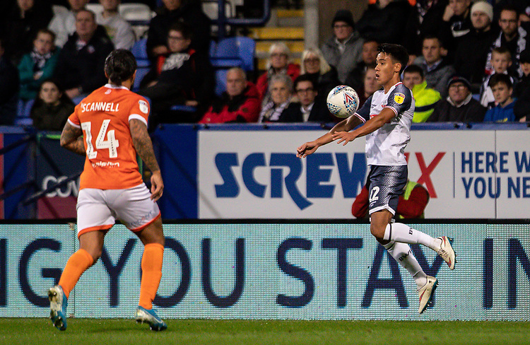 Bolton Wanderers' Adam Chicksen controlling the ball under pressure from Blackpool's Sean Scannell (left) <br /> <br /> Photographer Andrew Kearns/CameraSport<br /> <br /> The EFL Sky Bet League One - Bolton Wanderers v Blackpool - Monday 7th October 2019 - University of Bolton Stadium - Bolton<br /> <br /> World Copyright © 2019 CameraSport. All rights reserved. 43 Linden Ave. Countesthorpe. Leicester. England. LE8 5PG - Tel: +44 (0) 116 277 4147 - admin@camerasport.com - www.camerasport.com