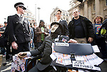 A comedy troupe parady a fat, greedy,corrupt  banker.<br /> Thousands of protesters marched on the Bank of England incity of London during the G20 conference meeting  in London April 2009 , RBS  Bank windows were smashed on the ground floor.  Police made around 90 arrests.