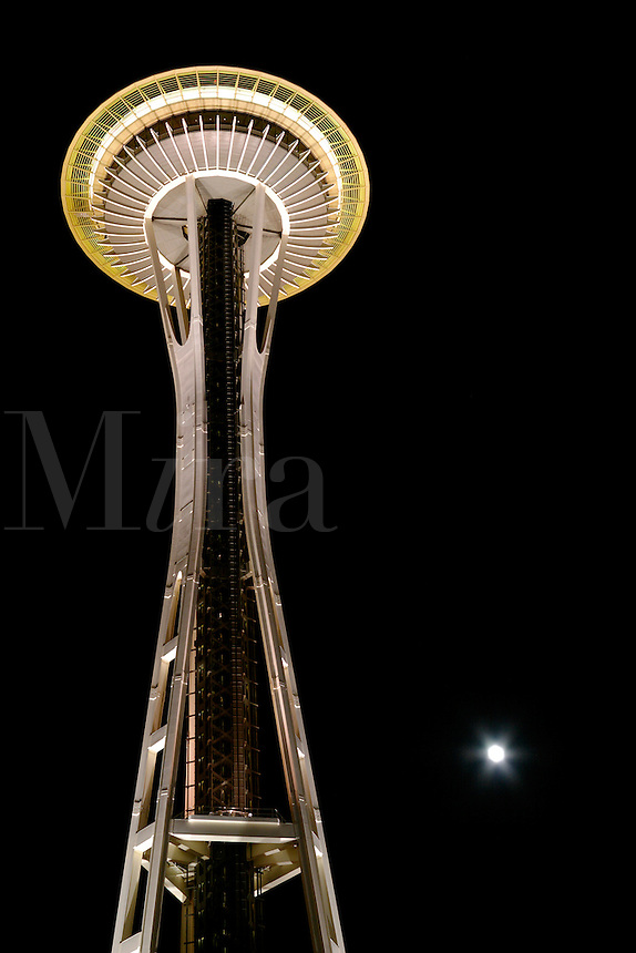 Nighttime scene of Seattle Space Needle towering above full moon, Seattle Center, Seattle, Washington, US