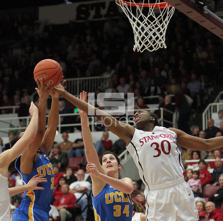 STANFORD, CA - January 20, 2011: Nnemkadi Ogwumike deflects a shot during Stanford's 64-38 victory over UCLA at Stanford, California on January 20, 2011.
