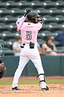 Hickory Crawdads Center fielder Miguel Aparicio (5) bats during the game with the Charleston Riverdogs at L.P. Frans Stadium on May 12, 2019 in Hickory, North Carolina.  The Riverdogs defeated the Crawdads 13-5. (Tracy Proffitt/Four Seam Images)