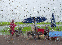 Rain drops and looking through the window during a heavy Monsoon shower, on the road between Siem Reap and Battambang, Cambodia