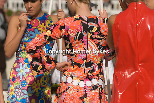 Goodwood Festival of Speed. Goodwood Sussex UK. Girls wearing retro clothes.