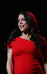 Bethenny Frankel walks the runway of The Heart Truth's Red Dress Collection on February 11, 2010 at Mercedes-Benz Fashion Week - Fall 2010 Collections at Bryant Park, NYC. (Photo by Sue Coflin/Max Photos)
