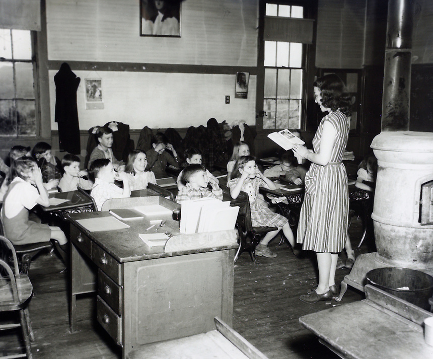 Elementary school classroom scene. 1950's.