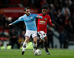 Bernardo Silva of Manchester City and Angel Gomes of Manchester United during the Carabao Cup match at Old Trafford, Manchester. Picture date: 7th January 2020. Picture credit should read: Darren Staples/Sportimage