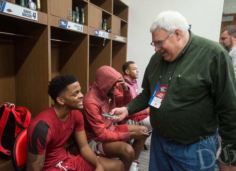 NWA Democrat-Gazette/BEN GOFF @NWABENGOFF<br /> Daryl Macon talks to Bob Holt from the Arkansas Democrat-Gazette Thursday, March 15, 2018, in the locker room during practice for the first round games of the NCAA Tournament at Little Caesars Arena in Detroit. Arkansas will face Butler in the opening round game Friday.