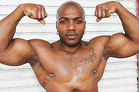Arm wrestler Charles shows off his muscles before a match at the Staten Island Borough Championship on June 18, 2005.