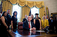 United States President Donald Trump, center, speaks as Tammie Jo Shults, a Southwest Airlines Co. captain, third left, and Darren Ellisor, a Southwest Airlines first officer, second left, listen while meeting with the crew and passengers of Southwest Airlines flight 1380 in the Oval Office of the White House in Washington, D.C., U.S., on Tuesday, May 1, 2018. An engine on Southwest's flight 1380, a Boeing Co. 737-700 bound for Dallas from New York's LaGuardia airport, exploded and made an emergency landing on April 17 sending shrapnel into the plane and killing a passenger seated near a window. <br /> Credit: Andrew Harrer / Pool via CNP /MediaPunch