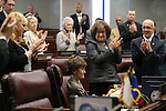 Lawmakers honor Former Lt. Governor and legislator Sue Wagner, seated at center, during an induction ceremony into the Senate Hall of Fame on the Senate floor at the Legislative Building in Carson City, Nev., on Wednesday, April 17, 2013. .Photo by Cathleen Allison