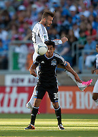 Stanford, California - Saturday June 30, 2012: David Beckham and Rafael Baca jumps for the ball during a game at Stanford Stadium, Stanford, Ca.San Jose Earthquakes defeated Los Angeles Galaxy,  4 to 3