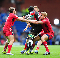 Kenya's Oscar Ouma Achieng is tackled by Wales's William Harries, left, and Wales's Jevon Groves<br /> <br /> Kenya Vs Wales - men's placing 5-8 match<br /> <br /> Photographer Chris Vaughan/CameraSport<br /> <br /> 20th Commonwealth Games - Day 4 - Sunday 27th July 2014 - Rugby Sevens - Ibrox Stadium - Glasgow - UK<br /> <br /> © CameraSport - 43 Linden Ave. Countesthorpe. Leicester. England. LE8 5PG - Tel: +44 (0) 116 277 4147 - admin@camerasport.com - www.camerasport.com
