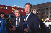 United States President George W. Bush (right) visits the Pentagon in Washington, DC during the late afternoon of 12 September 2001.  It was the day after Flight 77, an American Airlines Boeing 757, bound from Dulles International Airport, in northern Virginia, to Los Angeles, California, was hijacked by terrorists and deliberately crashed into the western side of the famous five-sided building.  Bush, joined by Secretary of Defense Donald Rumsfeld (left) expresses his condemnation of the attack, while praising the efforts of the many fire fighters, police officers, search and rescue personnel, FBI investigators, and other professionals at the disaster site.  The attack resulted in the deaths of all 64 passengers aboard the airliner plus the crew members and a still indeterminate number of Pentagon military and civilian personnel.  <br /> Credit: DoD via CNP