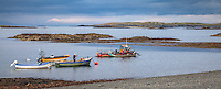 County Galway, Ireland: Colorful fishing boats at low tide on the North Atlantic, near Tullycross, along the Connemara Loop