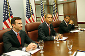 Washington, DC - January 6, 2009 -- United States President-elect Barack Obama answers questions from journalists after meeting with his economic team on Tuesday, January 6, 2009. The meeting included Rahm Emanuel, Chief of Staff-designate (unseen); Timothy Geithner, Treasury Secretary-designate (unseen); Peter Orszag, Director-designate, Office of Management and Budget (L); Rob Nabors, Deputy Director-designate, Office of Management and Budget (R); Christina Romer, Director-designate, Council of Economic Advisors (unseen) and Lawrence Summers, Director-designate, National Economic Council (unseen). During the meeting they reviewed the medium-term budget outlook and discussed their willingness to craft a budget that will reduce the deficit as the economy recovers..Credit: Aude Guerrucci - Pool via CNP