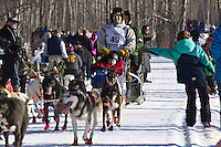 Ramey Smyth and team run past spectators on the bike/ski trail during the Anchorage ceremonial start during the 2014 Iditarod race.<br /> Photo by Britt Coon/IditarodPhotos.com