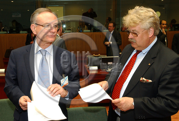 Brussels-Belgium - May 24, 2004---German MEPs Elmar BROK (ri) (Group of the European People's Party (Christian Democrats) and European Democrats/EPP/CDU) and Klaus HÄNSCH (Haensch) (le) (Group of the Party of the European Socialists/PES/SPD), both representatives of the European Parliament to the IGC (Intergovernmental Conference), at the beginning of the meeting of the European Foreign Ministers to prepare the IGC; at the 'Justus Lipsius', seat of the Council of the European Union in Brussels---Photo: Horst Wagner/eup-images
