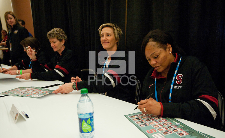 DENVER, CO--Coach Kate Paye speaks with a fan as the Cardinal sign posters during a fan autograph session at the Pepsi Center for the 2012 NCAA Women's Final Four festivities in Denver, CO.