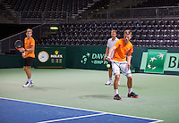 Switserland, Genève, September 16, 2015, Tennis,   Davis Cup, Switserland-Netherlands, Practise Dutch team, Tim van Rijthoven hits the ball under the watchful eye of Captain Jan Siemerink and Tallon Griekspoor (L)<br /> Photo: Tennisimages/Henk Koster