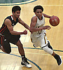 Danny Ashley #12 of Uniondale, right, gets pressured by Richie Rambarran #1 of Syosset during the Nassau County varsity boys basketball Class AA semifinals at SUNY Old Westbury on Tuesday, Feb. 28, 2017. Ashley scored a team-high 19 points in Uniondale's 69-44 win.