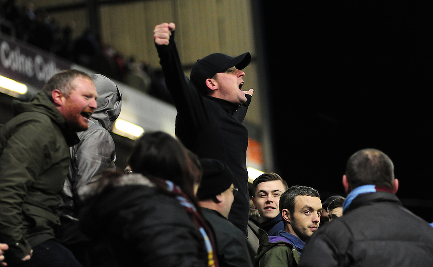 Burnley fans celebrate their sides 1-0 win over Manchester City<br /> <br /> Photographer Chris Vaughan/CameraSport<br /> <br /> Football - Barclays Premiership - Burnley v Manchester City - Saturday 14th March 2015 - Turf Moor - Burnley<br /> <br /> &copy; CameraSport - 43 Linden Ave. Countesthorpe. Leicester. England. LE8 5PG - Tel: +44 (0) 116 277 4147 - admin@camerasport.com - www.camerasport.com