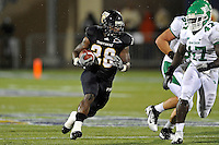 1 September 2011:  FIU running back Darriet Perry (28) carries the ball in the first half as the FIU Golden Panthers defeated the University of North Texas, 41-16, at FIU Stadium in Miami, Florida.