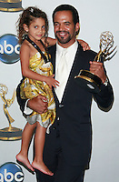 Actor Kristoff St. John poses with his daughter backstage after winning outstanding supporting actor in a drama series at the 35th Annual Daytime Emmy Awards held at the Kodak Theatre in Los Angeles on June 20, 2008.