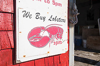 "A sign reads ""We buy lobsters"" at Island Seafood's ""bait shop"" where fishermen bring lobsters to sell to the dealer in on Badger's Island in Kittery, Maine, USA, on Wed., Jan. 31, 2018."
