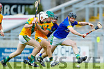Joe McElligott and Maurice O'Connor Kilmoyley in action against Stephen Power Lixnaw in the Kerry County Senior Hurling championship Final at Austin Stack Park on Sunday.