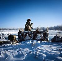 Lane Kugler (cq) walks past his duck blind after a hunting trip near Grand Island, Nebraska, Sunday, December 4, 2011. ..Photo by Matt Nager