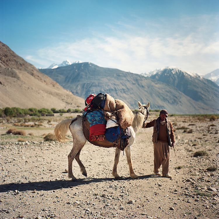 A Wakhi horseman leads his horse back to his home in the village of Ghaz Khan in the Wakhan Corridor.