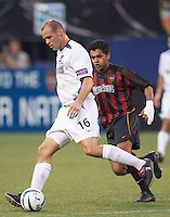 Craig Waibel of the Earthquakes being marked by Amado Guevara of the MetroStars. The San Jose Earthquakes and the the NY/NJ MetroStars played to a 4-4 tie on 7/02/03 at Giant's Stadium, NJ..