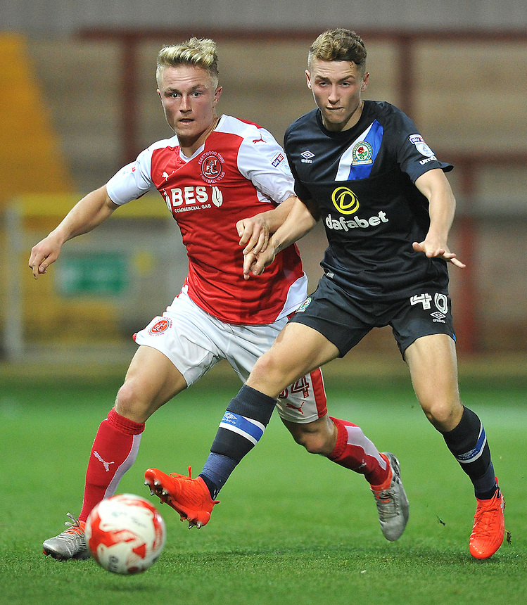 Fleetwood Town's Kyle Dempsey battles with Blackburn Rovers' Connor Thomson<br /> <br /> Photographer Bethany Hankey/CameraSport<br /> <br /> The Checkatrade Trophy - Fleetwood Town v Blackburn Rovers U23 - Tuesday 30 August 2016 - Highbury Stadium - Fleetwood<br />  <br /> World Copyright &copy; 2016 CameraSport. All rights reserved. 43 Linden Ave. Countesthorpe. Leicester. England. LE8 5PG - Tel: +44 (0) 116 277 4147 - admin@camerasport.com - www.camerasport.com