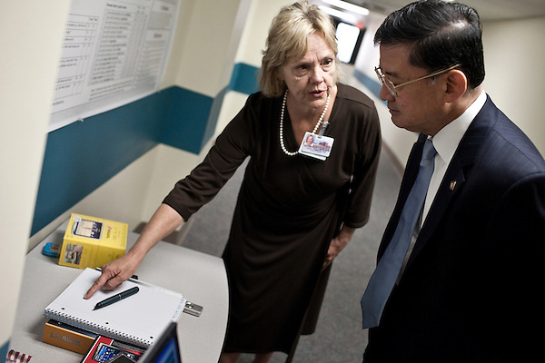 October 23, 2009. Durham, North Carolina.. Eric Shinseki, Secretary of Veterans Affairs for the Obama administration, visited Durham to meet with officials and veterans at the VA hospital, as well as to attend several events and meetings on the Duke University campus.. Sec. Shinseki, right,  took a tour of the VA hospital and met Carol Hammond, an audio pathologist, who showed him a pen used to help veterans with traumatic brain injury, TBI, by recording audio of a speaker as they take notes.