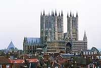 Lincoln: Lincoln Cathedral. View from Castle Ramparts. Conical Chapter House at left, the West Front Gothic Screen and Towers Preceoe 1185. Photo '90.