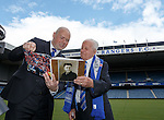 100 year old Rangers fan John Connelly with Ricki Neill of Rangers First presenting the supporter with a book on his life as a fan of the Glasgow club