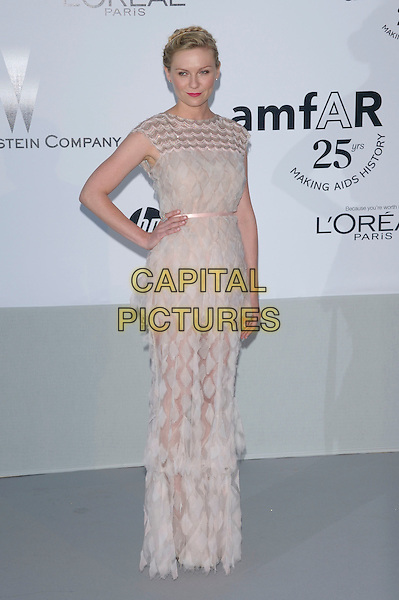 KIRSTEN DUNST.amfAR's Cinema Against AIDS Gala during the 64th Annual Cannes Film Festival at Hotel Du Cap, Antibes, France, May 19th, 2011..full length white lace sheer dress tiered hand on hip see thru through pale pink long maxi .CAP/PL.©Phil Loftus/Capital Pictures