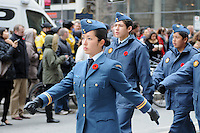 Royal Canadian Air Cadet Paiva and squad mates march along Queen Street West in front of Old City Hall during the Remembrance Day ceremony in Toronto, Ontario, Canada, November 11, 2011.