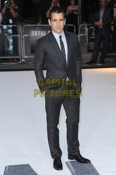 Colin Farrell.'Total Recall' UK film premiere at Vue cinema, Leicester Square, London..16th August 2012.full length suit hands in pockets blue shirt grey gray   .CAP/BEL.©Tom Belcher/Capital Pictures.