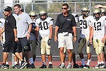 Beverly Hills, CA 09/23/11 - Coach Doug Esparza, Andrew Dizon (Peninsula #40), J.J. Accomando (Peninsula #29), Sam Weiss (Peninsula #12) in action during the Peninsula-Beverly Hills frosh football game at Beverly Hills High School.