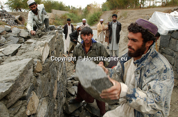 Afghanistan, Nangarhar Province (Jalalabad), Dih Bala District; November 11, 2002 -- Project region of Welthungerhilfe; here, construction site with men / villagers fortifying the basement of a new bridge; labour, infrastructure, people, rural -- Photo: © HorstWagner.eu
